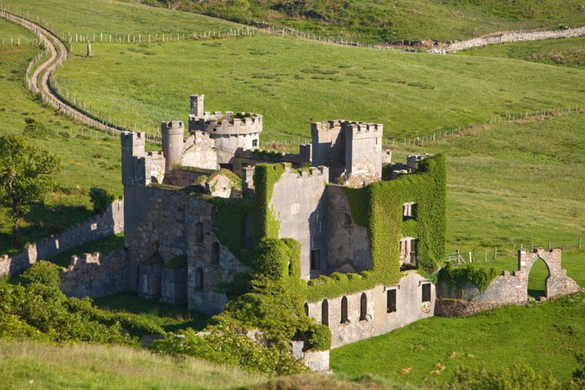 moss covered ancient ruins of 18th Century Clifden castle in galway ireland Sample