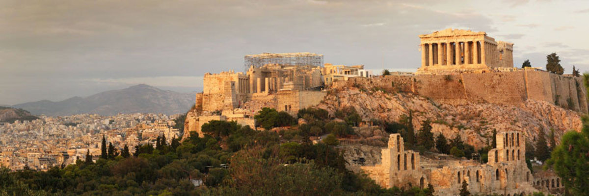 Acropolis of Athens in ancient Greece a settlement, especially a citadel, built upon an area of elevated ground
