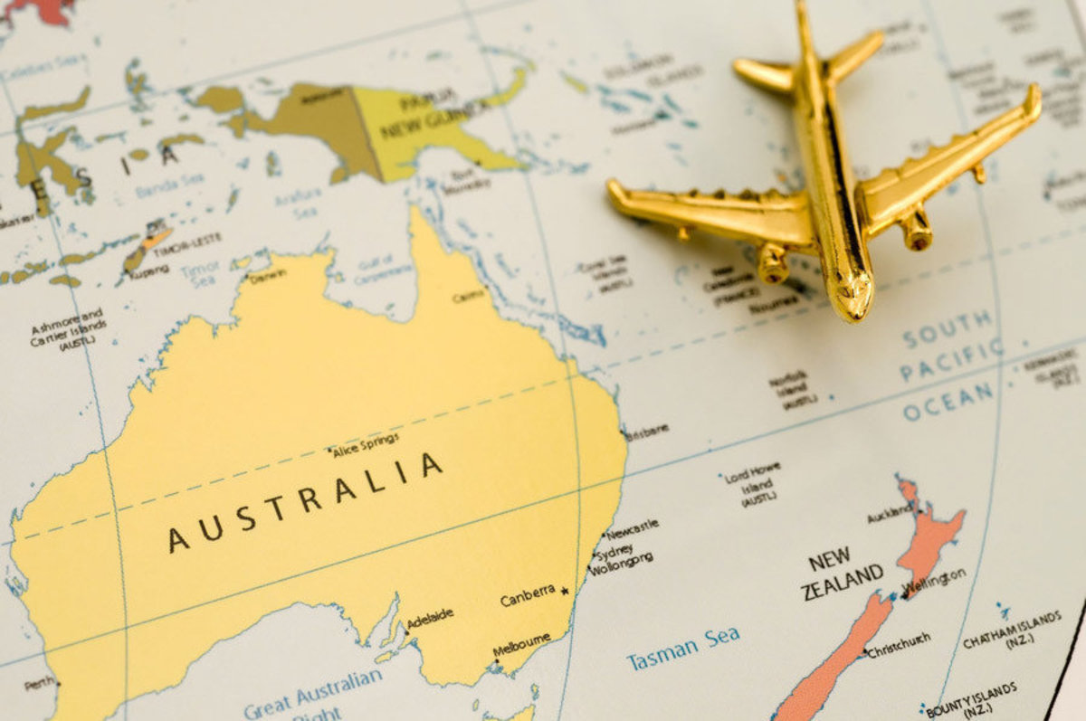 A golden plane approaches the great nation of Australia on a world map.  Additional Thumbnail