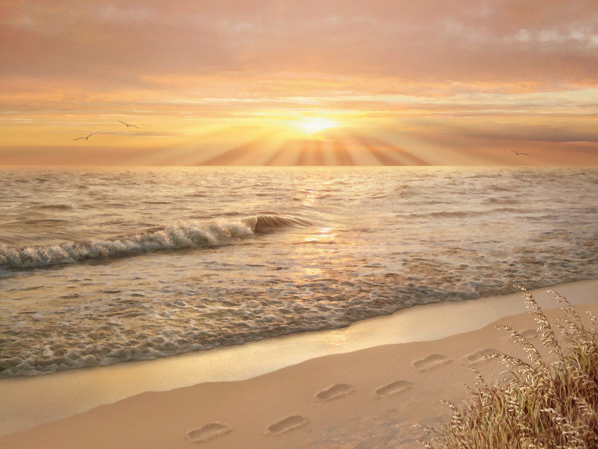 Biblical picture of footprints in the sand prayer with ocean waves and a beautiful sunset in the distance Sample