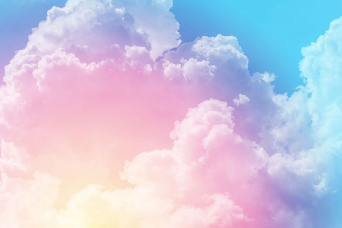 Enormous puffy clouds in a vivid color scheme fill this striking design Sample