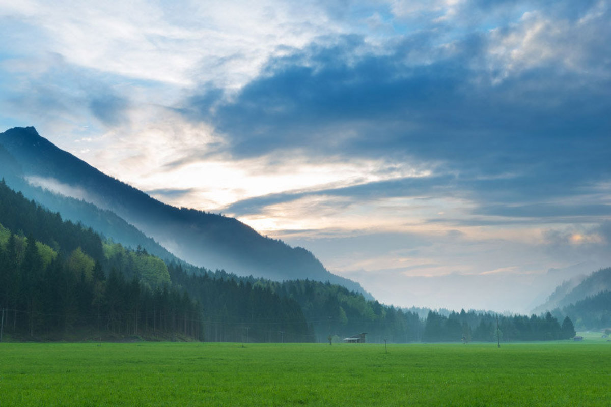 a misty morning vista of the Tyrol Alps in Austria Sample