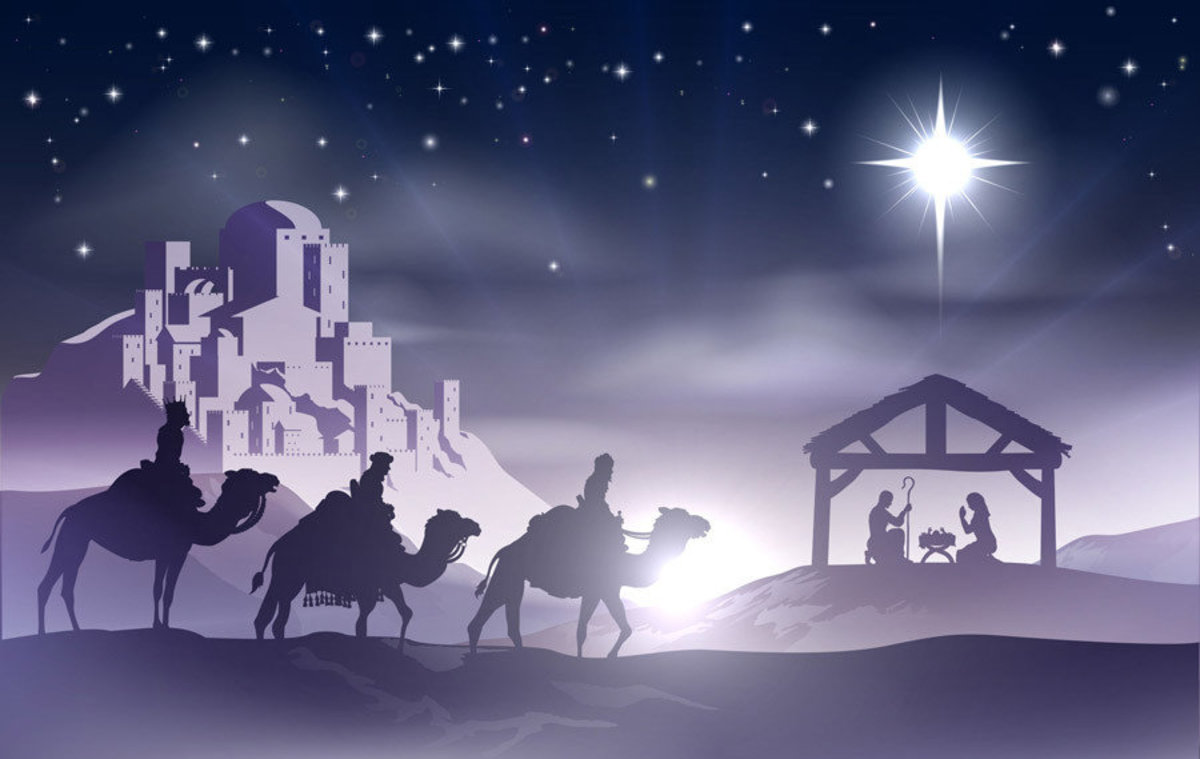 a nativity scene with baby Jesus in the manger in silhouette