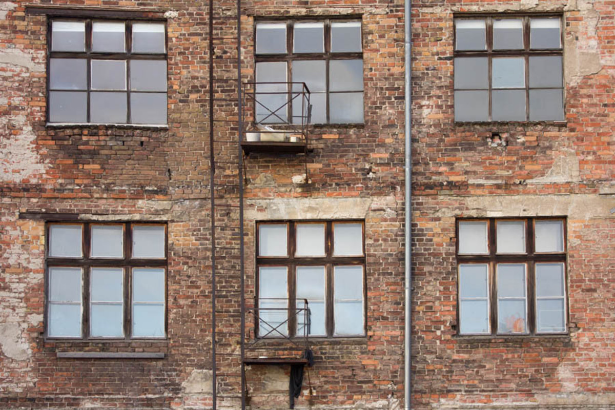 brick wall on old builing with windows Additional Thumbnail
