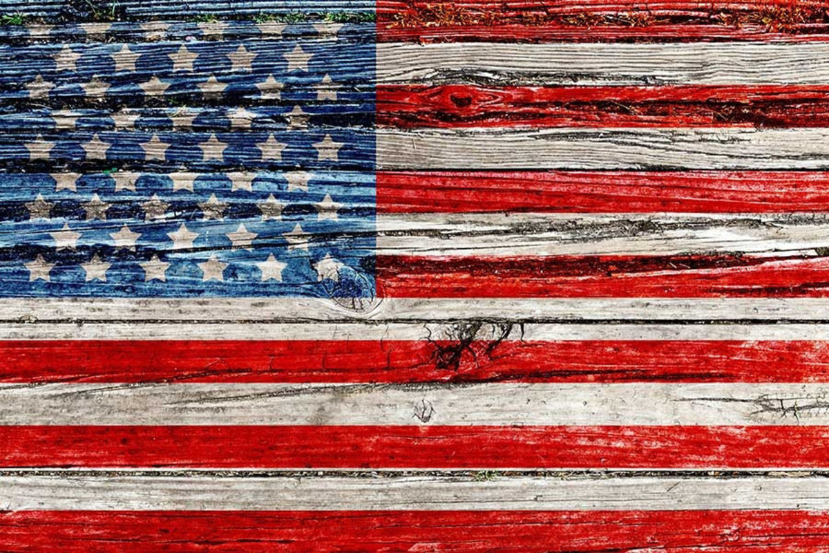 Picture of an American Flag painted on a wooden texture