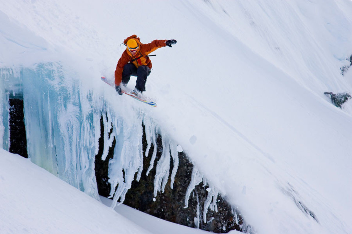 Snowboarding Over a Snowy Cliff Mural Wallpaper Sample