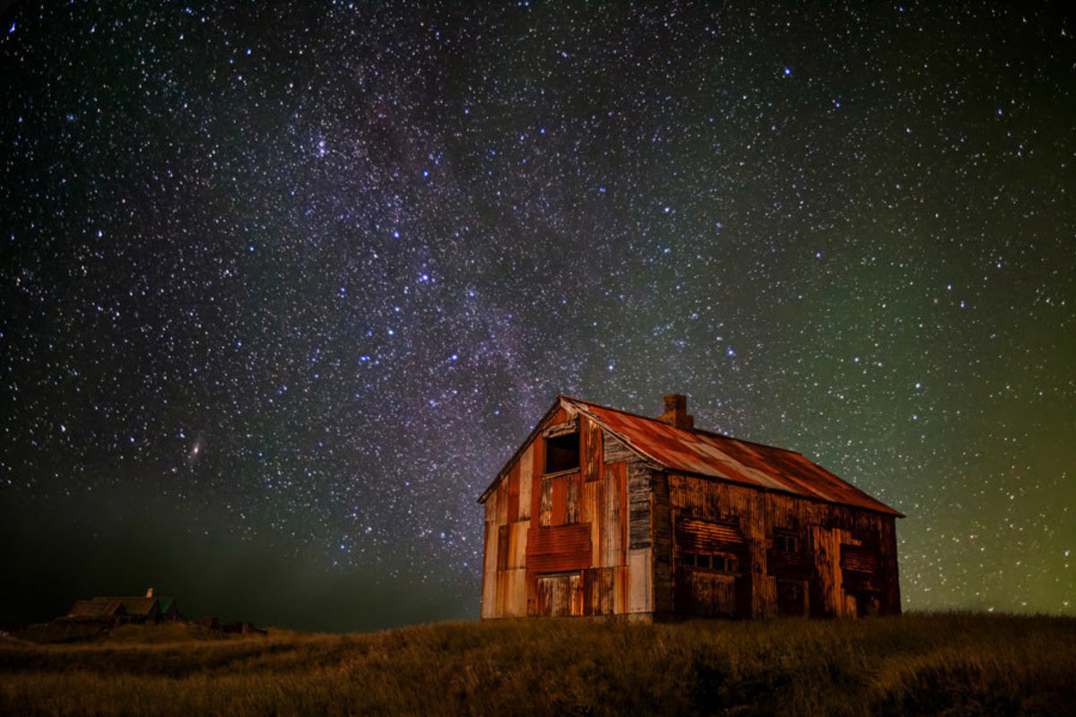 old barn surrounded by starlit sky Sample