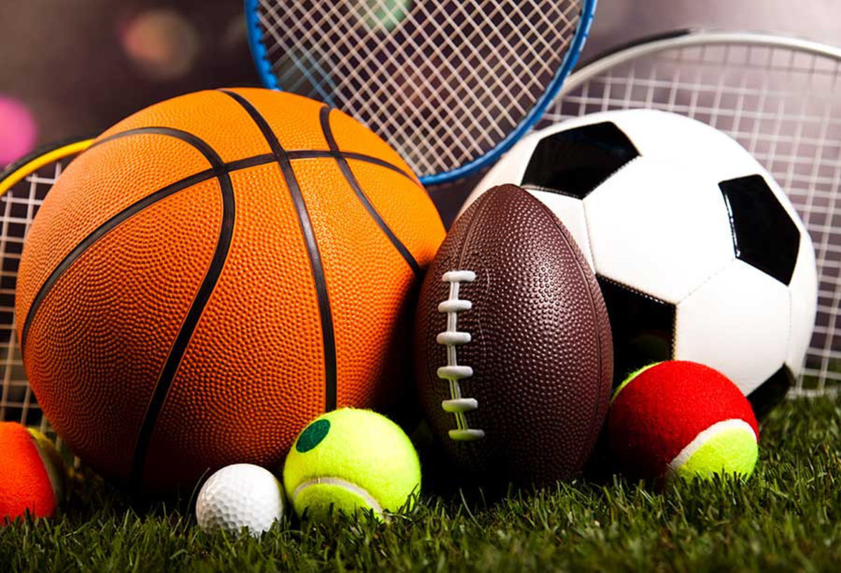 Sports Equipment In Grass Wallpaper Mural Sample